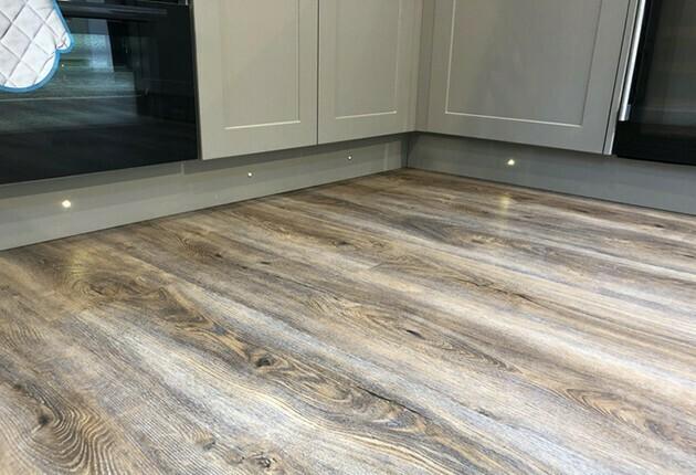 halogen lights under grey kitchen cabinets | McSwain Carpet & Floors