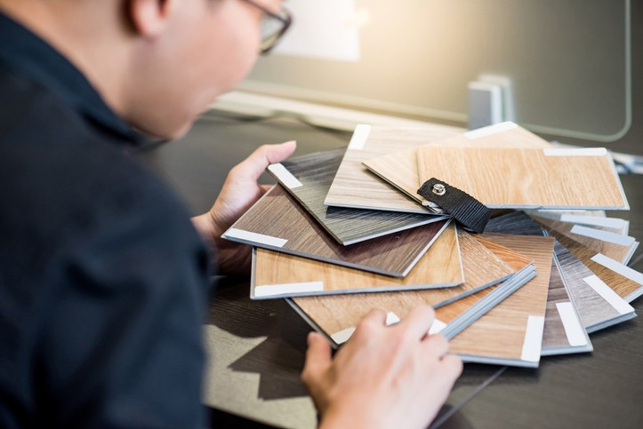 Male architect or interior designer holding wooden color swatch | McSwain Carpet & Floors