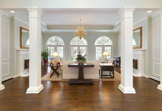 Grand Foyer and Living Room With White Pillars | McSwain Carpet & Floors